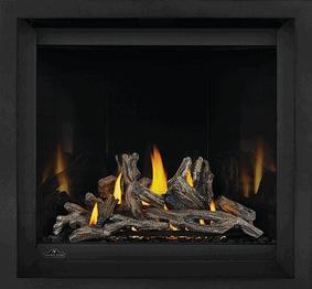 Image of Napoleon Altitude X 36 gas fireplace shown with Driftwood log set, Mirro-Flame Porcelain Radiant Reflective panels, Black Finish Trim
