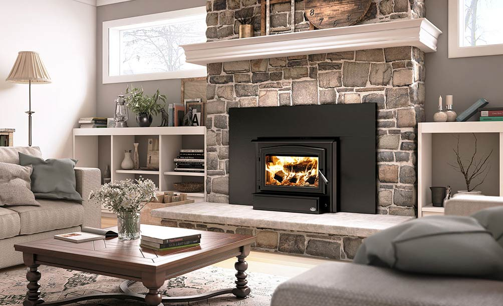 Osburn 1700 wood burning fireplace insert shown installed in living room fireplace