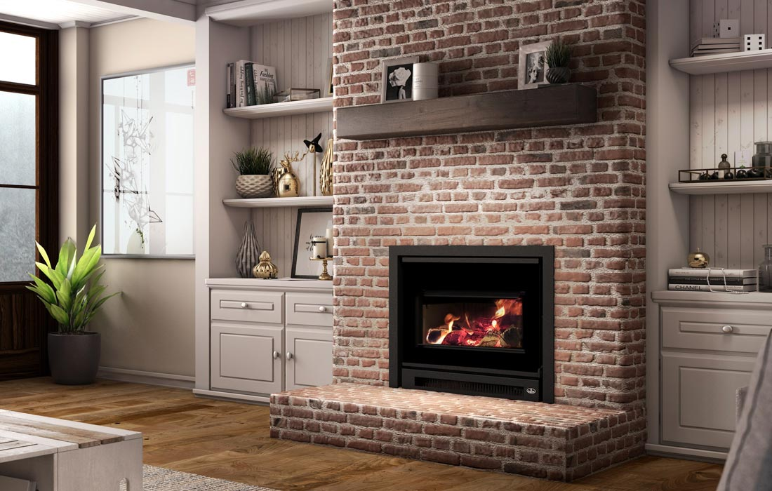 Osburn Inspire 2000-I wood insert installed in living room with narrow U-shaped faceplate