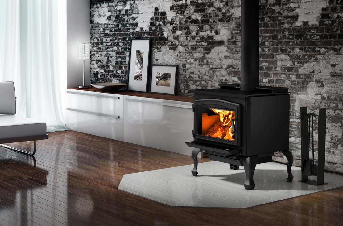 Osburn 2000 wood stove shown with black traditional legs in living space