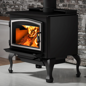 Osburn 2000 Wood Stove shown with Brushed Nickel Door Overlay and Black Cast Iron Traditional Leg Kit with Ash Drawer