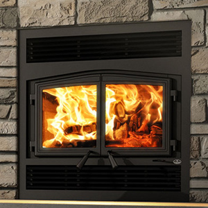 Osburn Stratford II wood fireplace with traditional faceplate and black door
