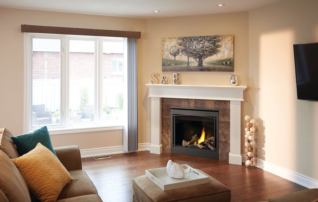 Napoleon Ascent 36 shown in living room with updated logs, zen front and mirro-flame radiant reflective porcelain panels
