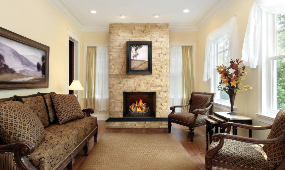 Napoleon Fiberglow vented gas logs shown in traditional living room fireplace