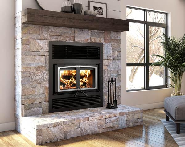 Osburn Everest II wood burning fireplace with brushed nickel door overlay